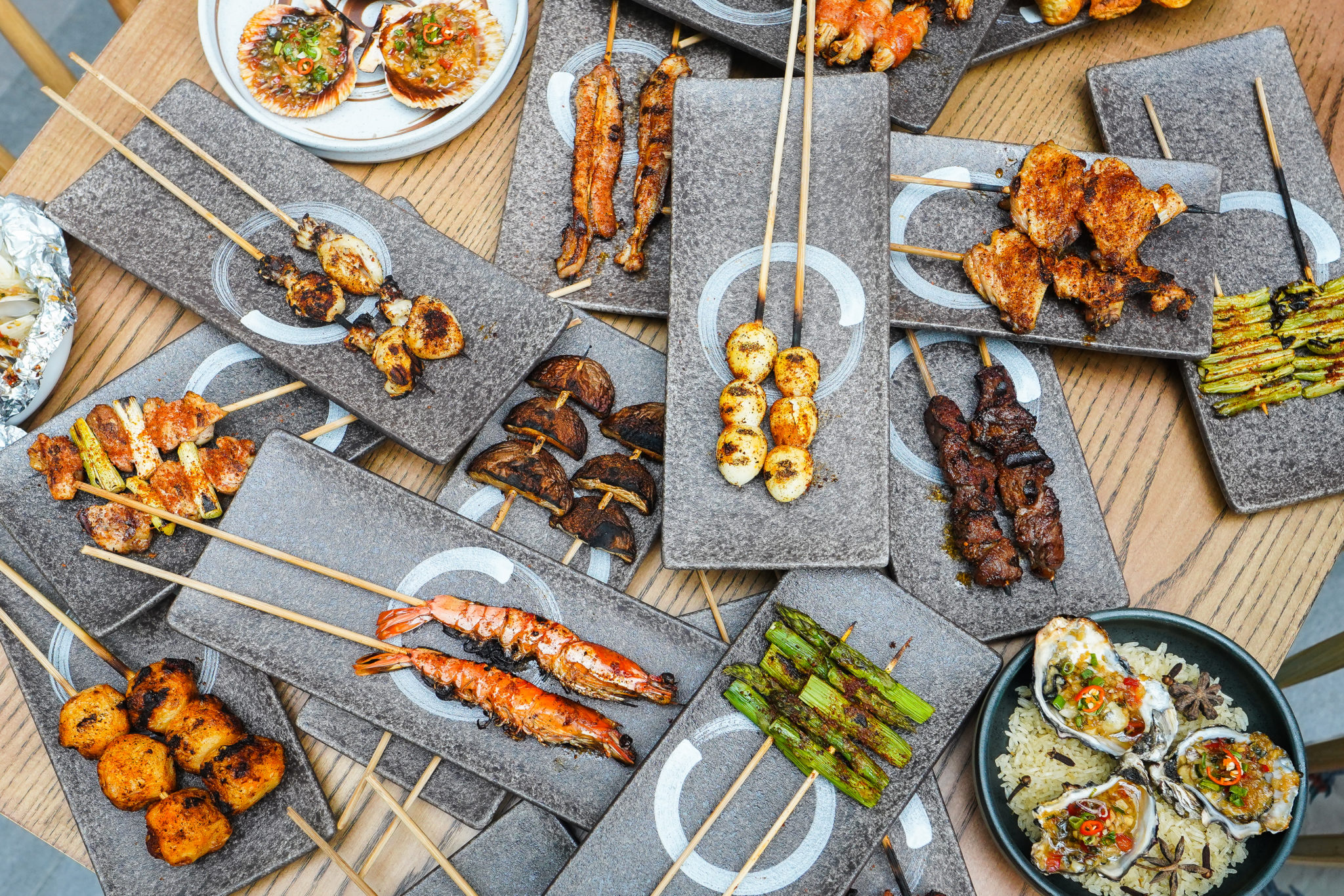 Fat Chap's Skewer Shao Kao party, with over 20 options of barbecued skewers and baked seafood. Skewer options include pork belly, quail egg, cuttlefish, tiger prawn, bacon wrapped scallop and more.